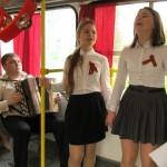 Поздравляем жителей города. Песни Великой Победы в городском транспорте.